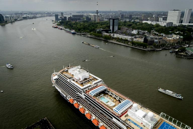 Holland America Line's MS Koningsdam -- seen here in Rotterdam in May 2016, on the eve of its dedication ceremony -- is now off the US West Coast, with 1,100 crew from eight different ships (AFP Photo/Robin van Lonkhuijsen)