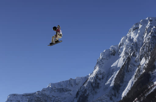 Shaun Whiteof the United States takes a jump during a Snowboard Slopestyle training session at the Rosa Khutor Extreme Park, prior to the 2014 Winter Olympics, Tuesday, Feb. 4, 2014, in Krasnaya Polyana, Russia. (AP Photo/Andy Wong)