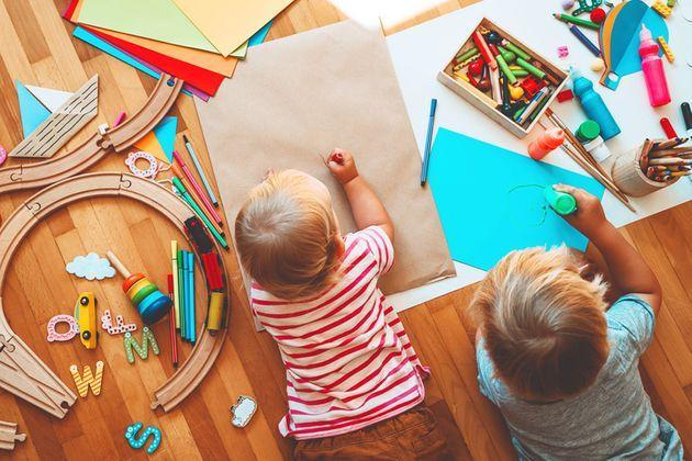 Kids draw and make crafts. Children with educational toys and school supplies for creativity. Background for preschool and kindergarten or art classes. Boy and girl play at home or daycare (Photo: NataliaDeriabina via Getty Images/iStockphoto)