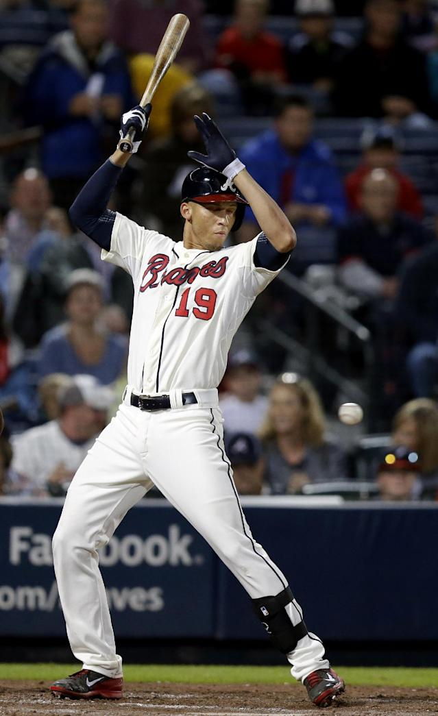 A pitch is thrown behind the back of Atlanta Braves' Andrelton Simmons by Washington Nationals' Stephen Strasburg in the second inning of a baseball game, Saturday, Aug. 17, 2013, in Atlanta. Strasburg was ejected on the play by home plate umpire Marvin Hudson. (AP Photo/David Goldman)