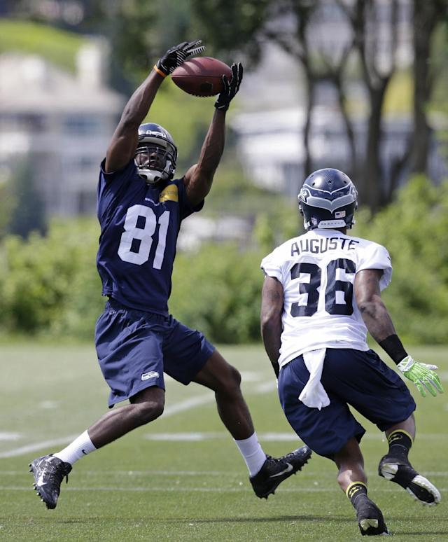Seattle Seahawks' Kevin Norwood (81) catches a pass in front of Akeem Auguste at NFL football rookie minicamp Saturday, May 17, 2014, in Renton, Wash. (AP Photo/Elaine Thompson)