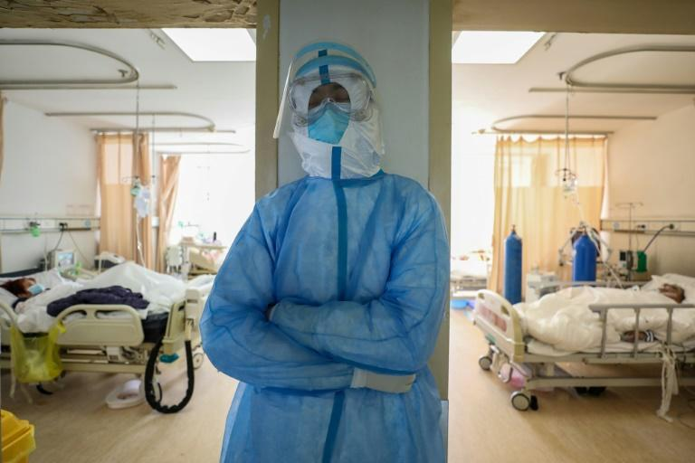 A medical staff member rests at the isolation ward of the Red Cross Hospital in Wuhan, China, the city which is the epicentre of the new coronavirus epidemic