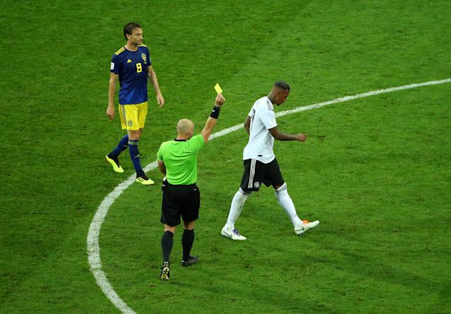Soccer Football - World Cup - Group F - Germany vs Sweden - Fisht Stadium, Sochi, Russia - June 23, 2018 Germany's Jerome Boateng is shown a yellow card by referee Szymon Marciniak REUTERS/Hannah McKay