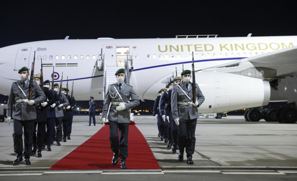 German honour guard leave after welcoming Britain's Prince Charles and his wife Camilla, Duchess of Cornwall at Berlin Brandenburg Airport, Germany, Saturday Nov. 14, 2020. (Odd Andersen/Pool via AP)