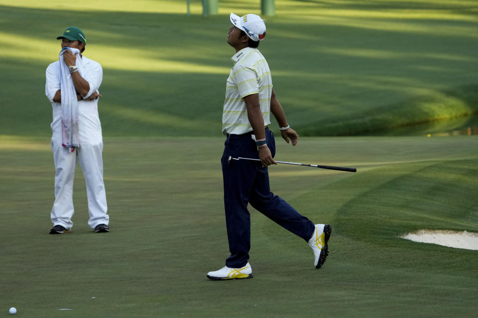 Hideki Matsuyama, of Japan, reacts after missing a putt on the 16th hole during the final round of the Masters golf tournament on Sunday, April 11, 2021, in Augusta, Ga. (AP Photo/Gregory Bull)