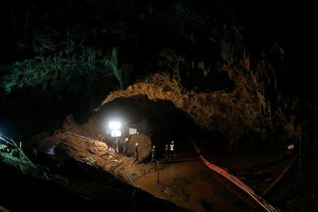 Soldiers walk after 12 soccer players and their coach were rescued near Tham Luang cave complex in the northern province of Chiang Rai, Thailand, July 10, 2018. REUTERS/Soe Zeya Tun