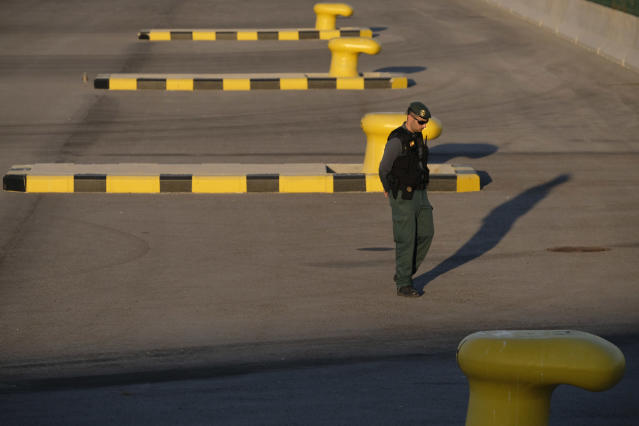 <p>Security patrols the docks awaiting the arrival of the rescue ship Aquarius. (Photo: José Colón for Yahoo News) </p>