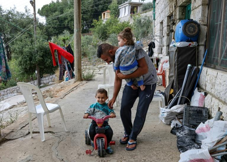Kawthar wants to be reunited with her husband Hassan al-Ali and their two other children who were sent back to Lebanon (AFP/Joseph EID)