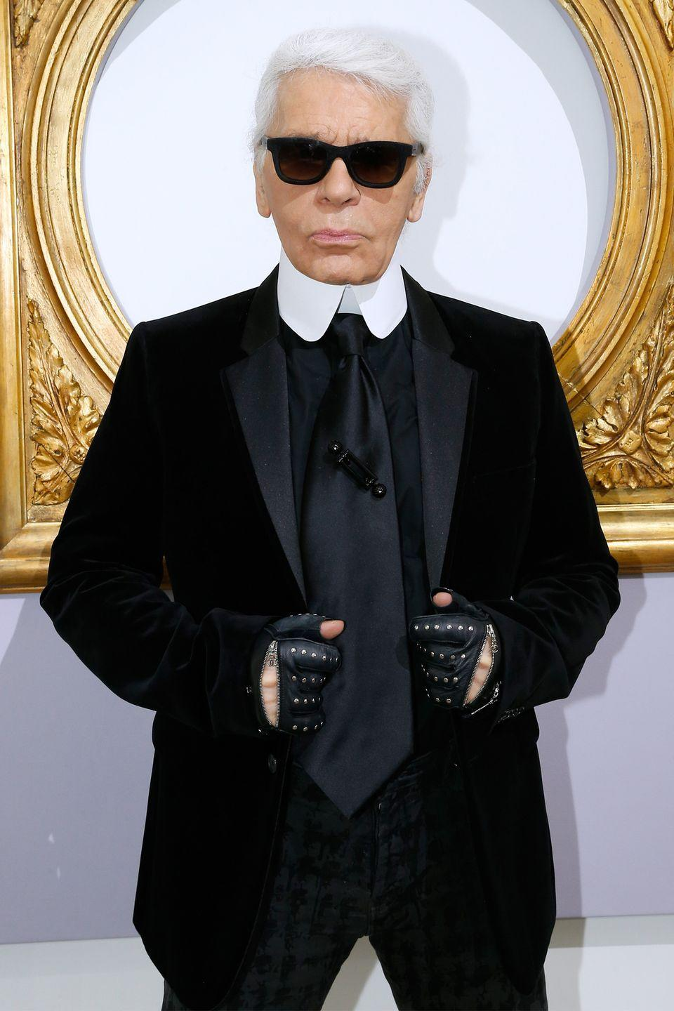 <p>The late fashion designer always added a pair of motorcycle gloves to his look, whether they were studded or bejeweled. </p>