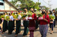 Protesters march with flower pots in Dawei, Myanmar