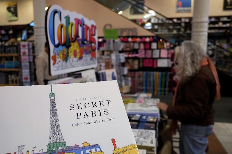 """Coloring is easy to do, requires no particular talent and brings back """"very fond memories"""" of being a child, according to one psychotherapist (AFP Photo/Jewel Samad)"""