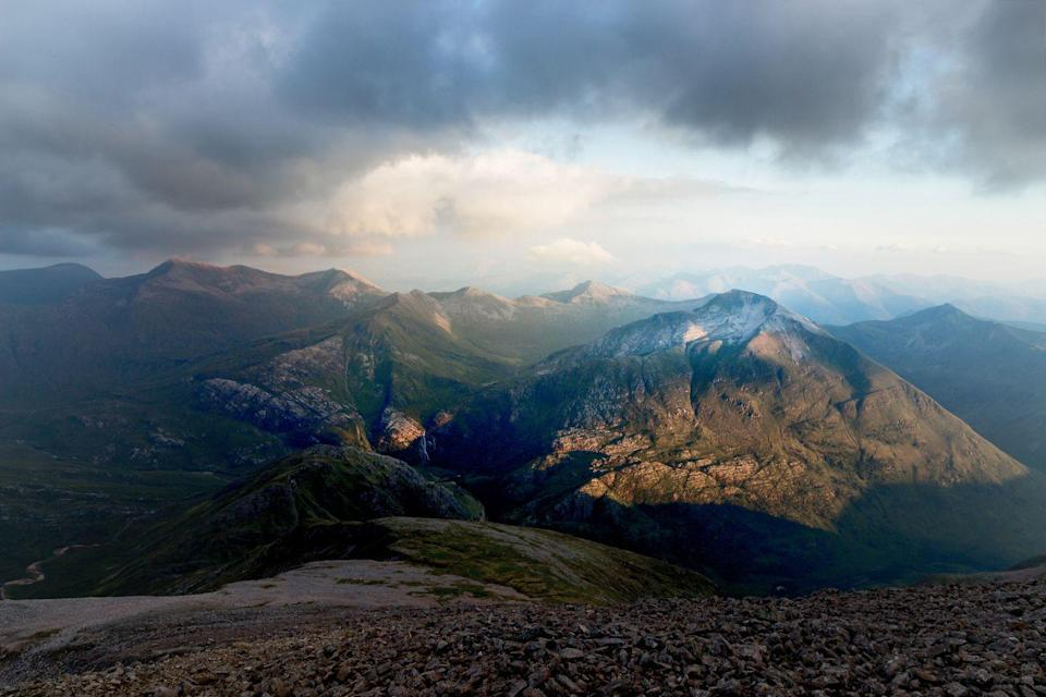 """<p>This is the view from the Summit of Ben Nevis, breathtaking after a strenuous climb.  </p><p><a class=""""link rapid-noclick-resp"""" href=""""https://www.countrylivingholidays.com/tours/scotland-rail-steam-tour-carol-kirkwood"""" rel=""""nofollow noopener"""" target=""""_blank"""" data-ylk=""""slk:SPOT BEN NEVIS DURING A TRIP WITH CAROL KIRKWOOD"""">SPOT BEN NEVIS DURING A TRIP WITH CAROL KIRKWOOD</a></p>"""