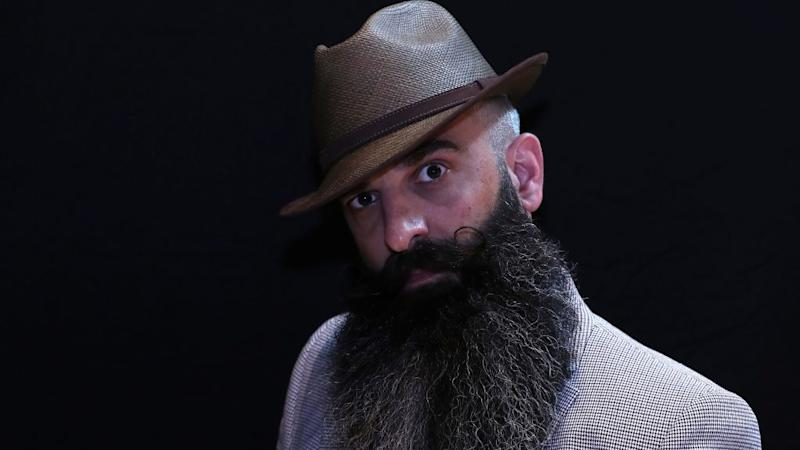 A participant of the international World Beard and Moustache Championships poses before taking part in one of the 17 categories of beard and moustache styles competing in Antwerp, Belgium May 18, 2019.