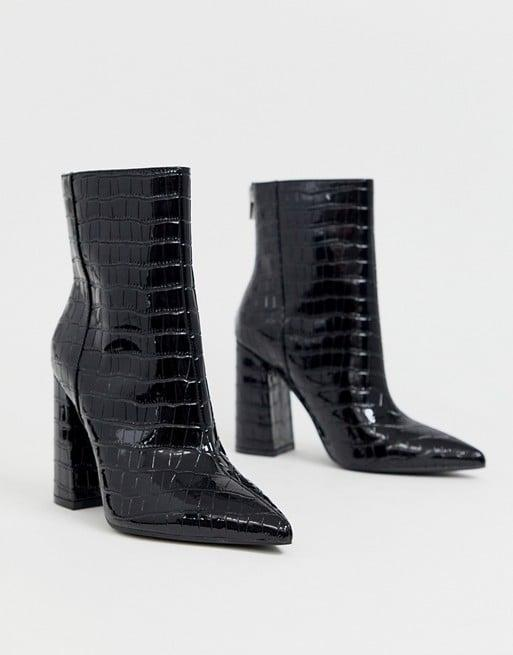 """<p><a href=""""https://www.popsugar.com/buy/London-Rebel-Wide-Fit-Pointed-Block-Heeled-Boots-489091?p_name=London%20Rebel%20Wide%20Fit%20Pointed%20Block%20Heeled%20Boots&retailer=us.asos.com&pid=489091&price=56&evar1=fab%3Aus&evar9=46565054&evar98=https%3A%2F%2Fwww.popsugar.com%2Ffashion%2Fphoto-gallery%2F46565054%2Fimage%2F46596465%2FLondon-Rebel-Wide-Fit-Pointed-Block-Heeled-Boots&list1=fall%20fashion%2Cshoes%2Cboots%2Ctrends%2Cfall&prop13=mobile&pdata=1"""" rel=""""nofollow"""" data-shoppable-link=""""1"""" target=""""_blank"""" class=""""ga-track"""" data-ga-category=""""Related"""" data-ga-label=""""https://us.asos.com/london-rebel/london-rebel-wide-fit-pointed-block-heeled-boot-in-black/prd/12476149?clr=black-patent&amp;colourWayId=16442882&amp;SearchQuery=wide%20fit%20boots"""" data-ga-action=""""In-Line Links"""">London Rebel Wide Fit Pointed Block Heeled Boots</a> ($56, originally $89)</p>"""
