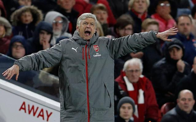 <span>Seemingly not yet getting his coat: Arsene Wenger watched his Arsenal side win without ever really impressing</span> <span>Credit: Reuters </span>