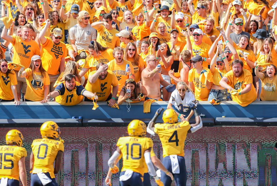 Mountaineers fans celebrate after a touchdown from running back Leddie Brown.
