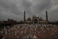 Indian Muslims wait as others leave after offering Eid al-Adha prayer at the Jama Masjid in New Delhi, India, Saturday, Aug.1, 2020. Eid al-Adha, or the Feast of the Sacrifice, by sacrificing animals to commemorate the prophet Ibrahim's faith in being willing to sacrifice his son. (AP Photo/Manish Swarup)