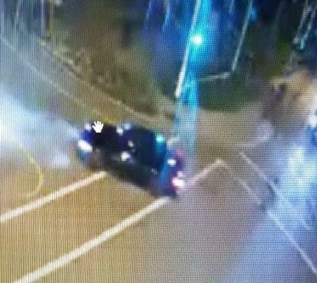 Surrey RCMP are searching for a black sedan after shots were fired at an officer Friday night.  (Surrey RCMP  - image credit)