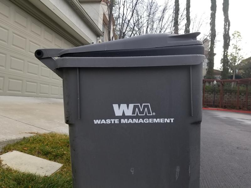 Close-up of gray trash bin with logo for recycling and landfill company Waste Management, San Ramon, California, February, 2019. (Photo by Smith Collection/Gado/Getty Images)