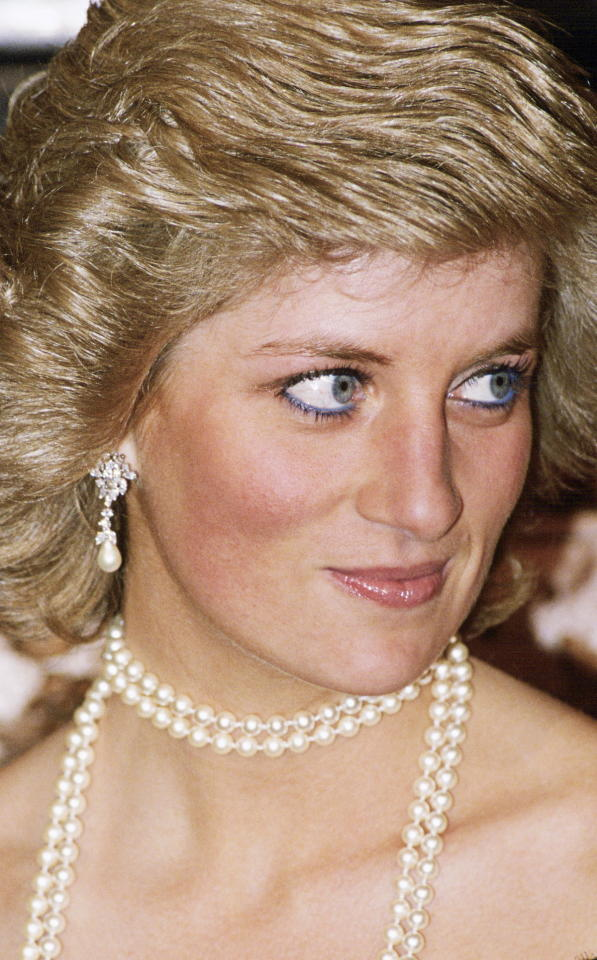 <p>Diana, Princess Of Wales's most stunning attribute may have been her bright blue eyes, and she often played them up with a touch of blue eyeliner and sometimes blue mascara. This might seem a bit tame in our world of extreme makeup tutorials, but at the time it was quite edgy. (Photo: Tim Graham/Getty Images) </p>