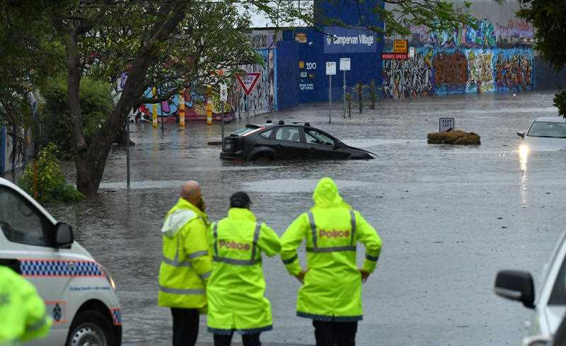 Flooded cars are seen on Longlands Street at Woolloongabba in Brisbane.
