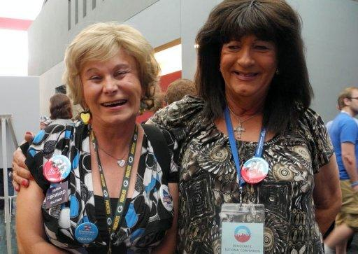 Transgender delegates Jamie Shier (L) and Janice Covington pose for photographs at the Convention Center