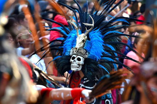 <p>Participants are seen during the traditional Day of the Dead parade at Reforma Avenue in Mexico City, Mexico on Oct. 28, 2017. (Photo: Carlos Tischler/REX/Shutterstock) </p>