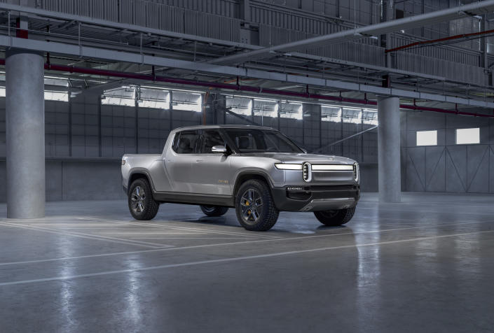 This photo provided by Rivian Automotive shows the R1T, the first widely available electric pickup on the market. Its 0-60 mph time of three seconds will get you to your local home improvement store in a jiff. (Ross Martin/Courtesy of Rivian Automotive via AP)