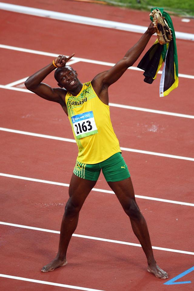 BEIJING - AUGUST 16: Usain Bolt of Jamaica celebrates winning the Men's 100m Final and the gold medal at the National Stadium on Day 8 of the Beijing 2008 Olympic Games on August 16, 2008 in Beijing, China. Bolt finished the event in first place with a time of 9.69, a new World Record. (Photo by Mike Hewitt/Getty Images)