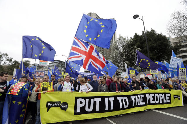 Demonstrators hold a banner during a Peoples Vote anti-Brexit march in London, Saturday, March 23, 2019. The march, organized by the People's Vote campaign is calling for a final vote on any proposed Brexit deal. This week the EU has granted Britain's Prime Minister Theresa May a delay to the Brexit process. (AP Photo/Kirsty Wigglesworth)