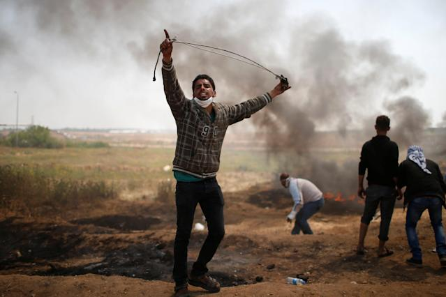 <p>A Palestinian demonstrator shouts during clashes with Israeli troops at a protest demanding the right to return to their homeland, at the Israel-Gaza border east of Gaza City April 6, 2018. (Photo: Mohammed Salem/Reuters) </p>