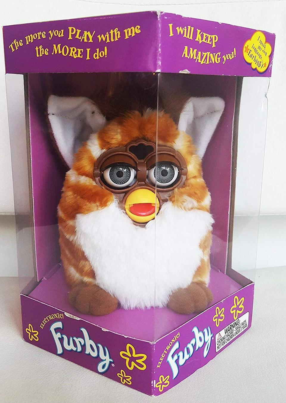 """<p>Furby was one of the most annoying toys to come out of the '90s, and in a cruel twist of fate, they're now somehow worth almost <a href=""""https://www.ebay.com/itm/NIB-1998-ORIGINAL-FURBY-70-800-Gray-Black-Spots-Pink-Belly-Ear-BOX-damage-BG/292910661368?epid=19033158937&hash=item4432d5fef8:g:q6UAAOSwCEhcNXQx:sc:USPSPriority!11231!US!-1"""" rel=""""nofollow noopener"""" target=""""_blank"""" data-ylk=""""slk:$1k"""" class=""""link rapid-noclick-resp"""">$1k</a>. Like...why would anyone buy this? I NEED ANSWERS. </p>"""