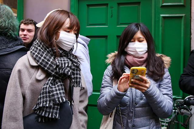 Women are seen in central London wearing protective face masks as they take precaution against coronavirus (AP)