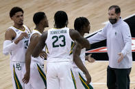 Baylor head coach Scott Drew, right, talks to his players during the first half of an NCAA college basketball game against Kansas State in the second round of the Big 12 Conference tournament in Kansas City, Mo., Thursday, March 11, 2021. (AP Photo/Charlie Riedel)