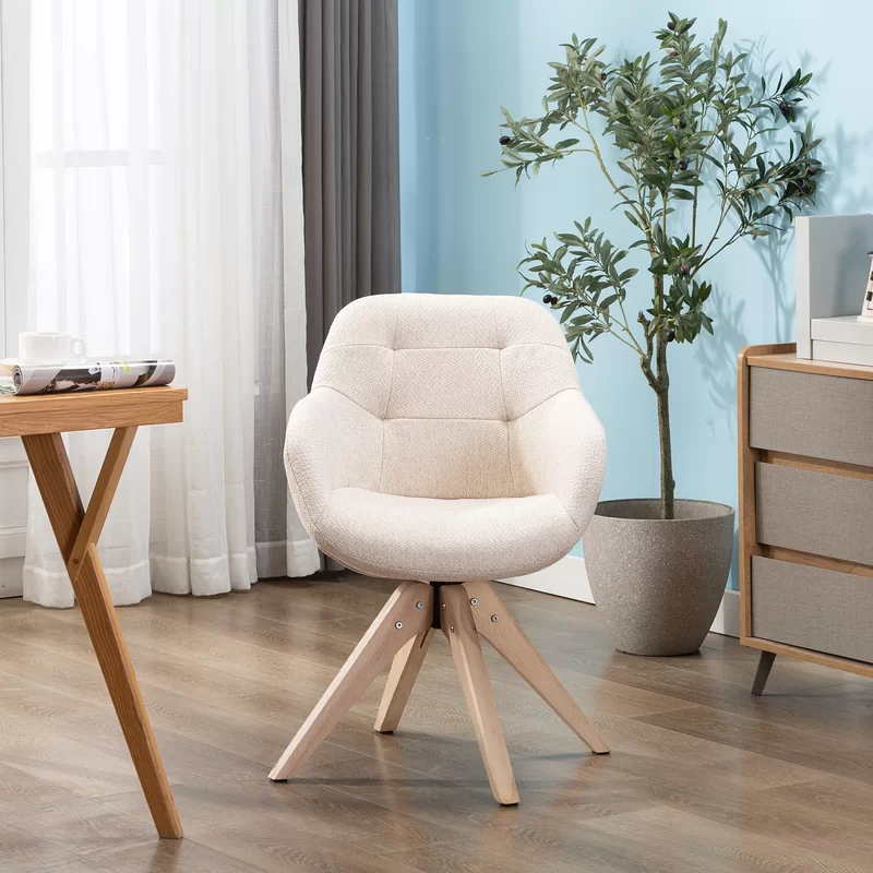 """<h3>Corrigan Studio Giacchetto Swivel Armchair</h3><br><strong>Best For: Comfy-Compact Support</strong><br>This cute cotton-blend armchair provides comfy deep-pocketed support in a compact frame that reviewers love to sit in while WFH – it also packs a stylish wheel-less frame and secret-swivel capabilities.<br><br><strong>The Hype: </strong>4.7 out of 5 stars and 94 reviews on <a href=""""https://www.wayfair.com/furniture/pdp/brayden-studio-giacchetto-swivel-armchair-w000868120.html"""" rel=""""nofollow noopener"""" target=""""_blank"""" data-ylk=""""slk:Wayfair"""" class=""""link rapid-noclick-resp"""">Wayfair</a><br><br><strong>Comfy Butts Say: </strong>""""I love the chair, it's the perfect height for my desk and it's super comfortable. The seat itself is deeper, going backward than I expected, but not a complaint at all. I highly recommend it; it's stylish and comfy."""" and """"I love it!!!! No more backaches while I work!!! Side note I wear a women's size four with a booty and thighs, the seat is not tight but it's on the smaller side for people with thick thighs and butts.""""<br><br><strong>Corrigan Studio</strong> Giacchetto Swivel Armchair, $, available at <a href=""""https://go.skimresources.com/?id=30283X879131&url=https%3A%2F%2Fwww.wayfair.com%2Ffurniture%2Fpdp%2Fcorrigan-studio-giacchetto-swivel-armchair-w003517057.html"""" rel=""""nofollow noopener"""" target=""""_blank"""" data-ylk=""""slk:Wayfair"""" class=""""link rapid-noclick-resp"""">Wayfair</a>"""
