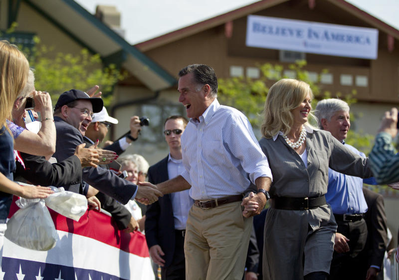 Republican presidential candidate, former Massachusetts Gov. Mitt Romney, left, Ann Romney, center, and Gov. Rick Snyder, R-Mich., arrive for a campaign stop at Bavarian Inn Lodge on Tuesday, June 19, 2012 in Frankenmuth, Mich. (AP Photo/Evan Vucci)