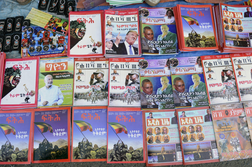 Newspapers and magazines reporting on the current military confrontation in the country are seen at a news stand on a street in the capital Addis Ababa, Ethiopia Saturday, Nov. 7, 2020. Ethiopia moved Saturday to replace the leadership of the country's defiant northern Tigray region, where deadly clashes between regional and federal government forces are fueling fears the major African power is sliding into civil war. (AP Photo/Samuel Habtab)