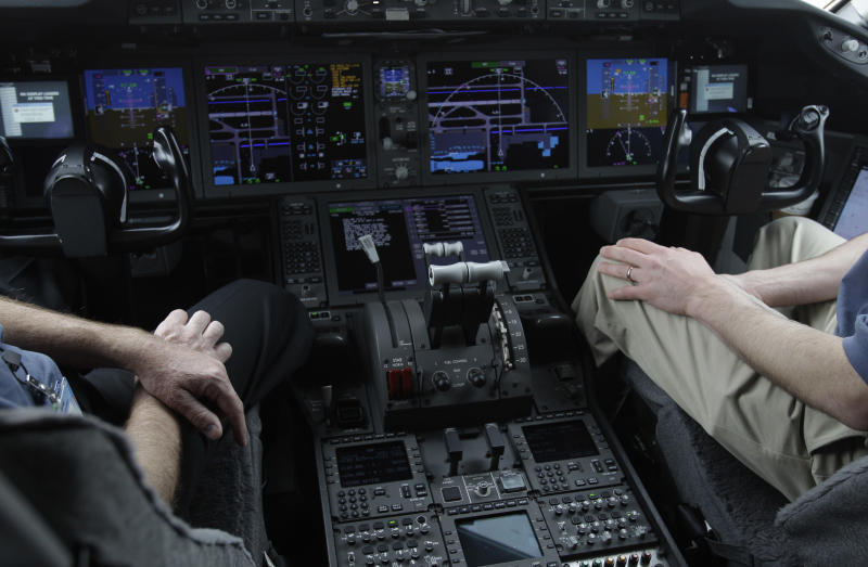 In this Feb. 3, 2011, photo, the cockpit of Boeings' new 787 Dreamliner is photographed in Houston. Pilots are becoming so reliant on the computer systems that do most of the flying in today's airliners that on the rare occasions when something goes wrong, they're sometimes unprepared to take control, according to aviation safety experts and government and industry studies. Increasing automation has been a tremendous safety boon to aviation, contributing to historically low accident rates in the U.S. and many parts of the world. (AP Photo/Pat Sullivan)