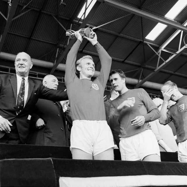 Bobby Moore lifts the Jules Rimet trophy at Wembley in 1966 (PA).