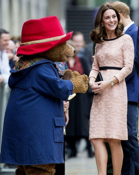 PHOTO: Britain's Catherine, Duchess of Cambridge, smiles with a person in a Paddington Bear outfit by her husband Britain's Prince William, Duke of Cambridge as they attend a charities forum event at Paddington train station in London, Oct. 16, 2017. (REX/Shutterstock)