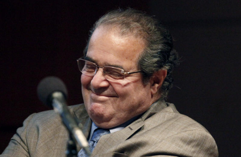 "FILE - In this Oct. 18, 2011, file photo U.S. Supreme Court justice Antonin Scalia smiles during a college address in Chicago. Scalia said late Wednesday July 18, 2012, that he hasn't had a ""falling out"" with Chief Justice John Roberts over the Supreme Court's landmark 5-4 decision validating much of President Barack Obama's health care overhaul.""There are clashes on legal questions but not personally,"" Scalia said of the court. (AP Photo/Charles Rex Arbogast, File)"
