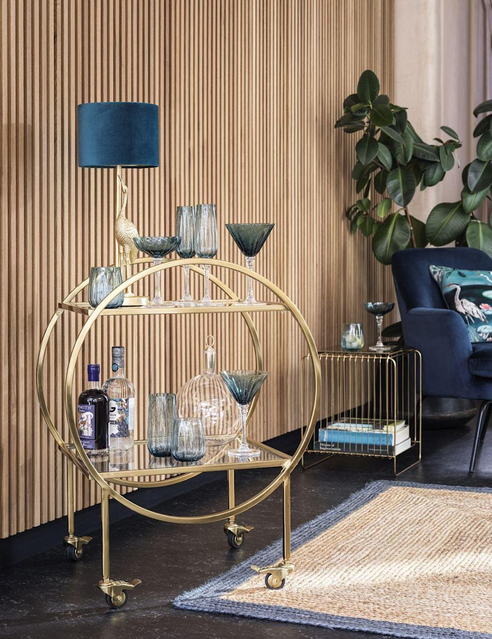 <p>Show off your pretty glasses with this on-trend gold circular drinks trolley. With hopes we can all entertain inside during the winter months, there's nothing better than wheeling out this trolley to impress guests. </p><p>'As people have embraced more adventurous homemixology with their drink choices over the past year, we've seen a huge increase in sales of barware and stemmed glass styles,' says Kate Gibson<br>Kitchenshop, Buying Manager. </p>