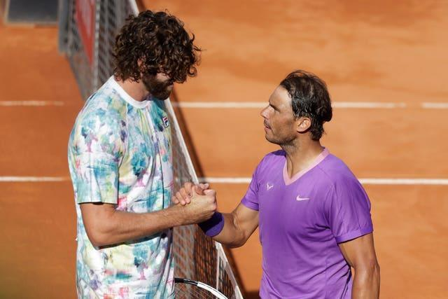 Rafael Nadal (right) defeated seven-foot-tall Reilly Opelka