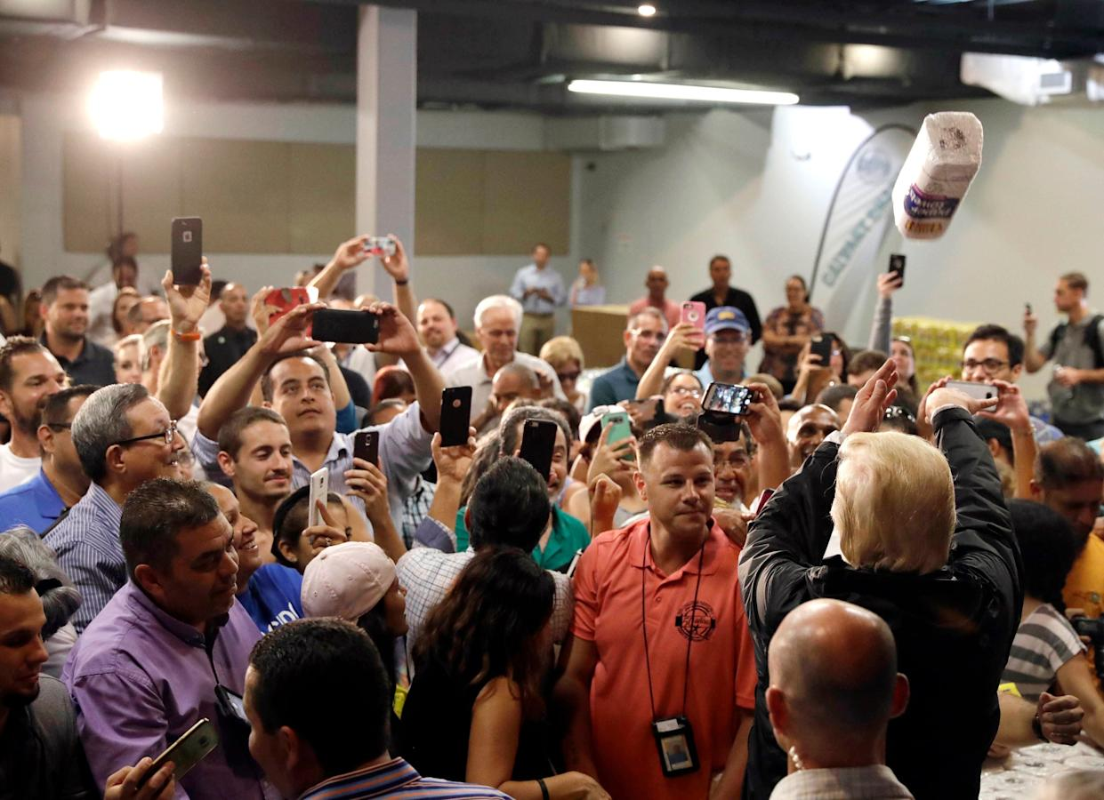 President Trump throws a roll of paper towels to a crowd affected by Hurricane Maria in October 2017. (Photo: Evan Vucci/AP)