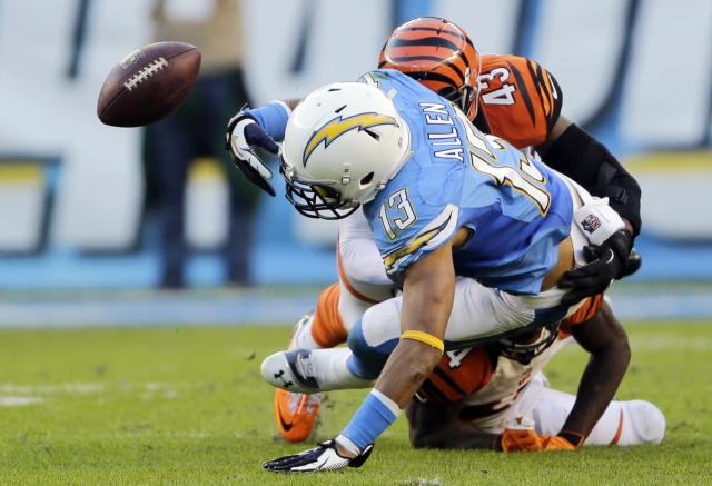 San Diego Chargers wide receiver Keenan Allen fumbles the ball as he is hit by Cincinnati Bengals strong safety George Iloka, above, and cornerback Adam Jones, below during the second half of an NFL football game Sunday, Dec. 1, 2013, in San Diego. (AP Photo/Lenny Ignelzi)