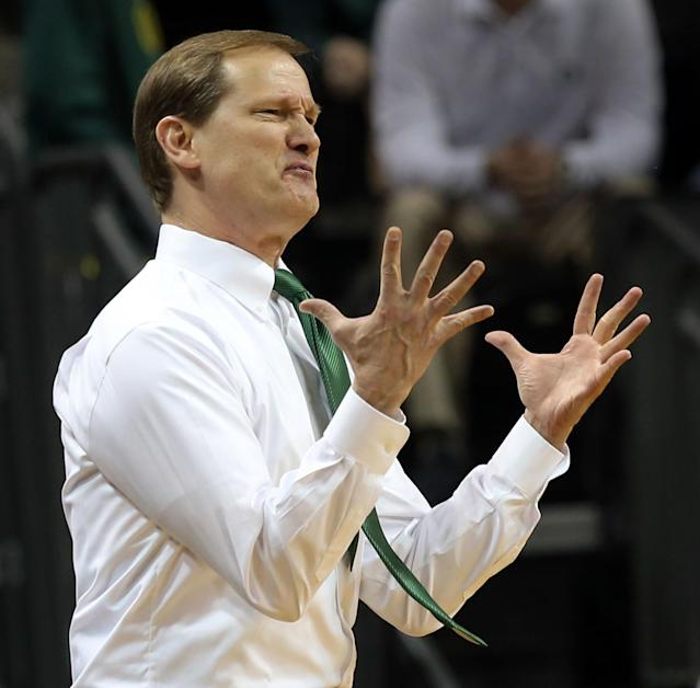 Oregon head coach Dana Altman reacts during the first half of an NCAA college basketball game against Oregon State in Eugene, Ore., Sunday, Feb. 16, 2014. (AP Photo/Chris Pietsch)