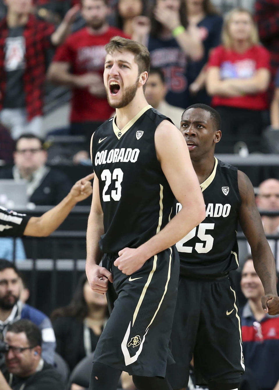 Colorado's Lucas Siewert (23) reacts after sinking a 3-point shot during the first half of an NCAA college basketball game against Arizona in the quarterfinals of the Pac-12 men's tournament Thursday, March 8, 2018, in Las Vegas. (AP Photo/Isaac Brekken)