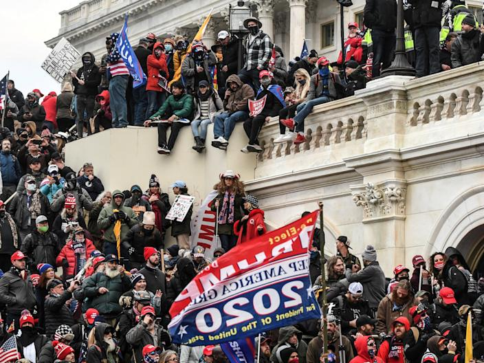 """<p>Supporters of Donald Trump gather at the west entrance of the Capitol during a """"Stop the Steal"""" protest outside of the Capitol building in Washington DC on 6 January 2021</p> ((Reuters))"""
