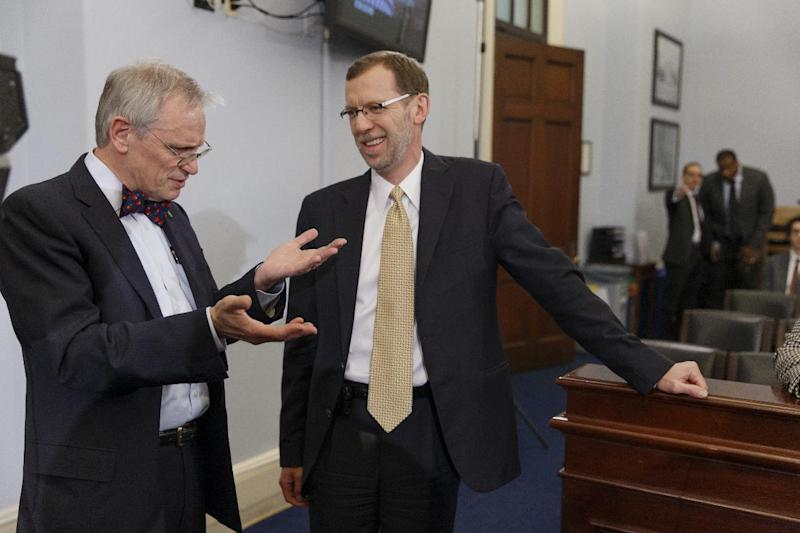 Congressional Budget Office (CBO) Director Douglas Elmendorf, right, talks with House Budget Committee member Rep. Earl Blumenauer, D-Ore. on Capitol Hill in Washington, Wednesday, Feb. 5, 2014, prior to Elmendorf testifying before the committee's hearing on the CBO budget and economic outlook. New estimates that President Barack Obama's health care law will encourage millions of Americans to leave the workforce or reduce their work hours have touched off an I-told-you-so chorus from Republicans, who've claimed all along that the law will kill jobs. (AP Photo/J. Scott Applewhite)
