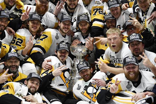 <p>Pittsburgh Penguins players pose for a team photo with the Stanley Cup after defeating the Nashville Predators in Game 6 of the 2017 Stanley Cup Final at Bridgestone Arena. Credit: Christopher Hanewinckel-USA TODAY Sports </p>